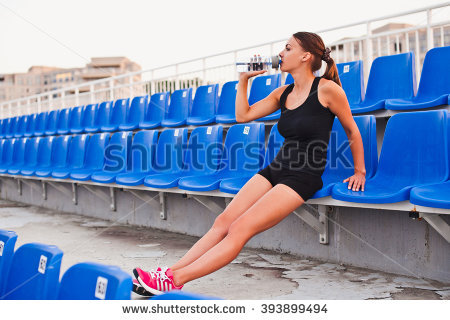 stock-photo-sporty-young-attractive-thirsty-girl-in-sportswear-relaxing-after-hard-workout-sit-and-drink-water-393899494
